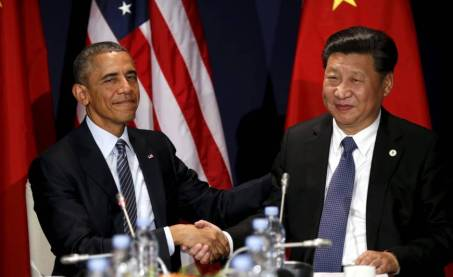 u-s-president-barack-obama-shakes-hands-with-chinese-president-xi-jinping-during-their-meeting-at-the-start-of-the-climate-summit-in-paris-on-monday-reuters